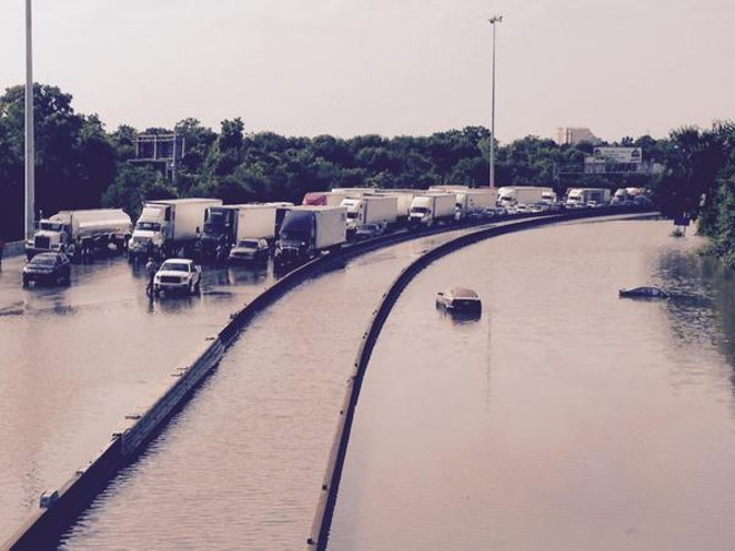 Flood waters this morning on Interstate 45 in Houston. - VIA TWITTER USER @RCROCKER