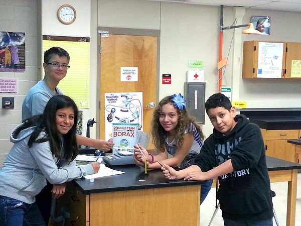 Anthony Holmes, 13, Jacob Rubio, 11, Kalista Ybarra, 12, Madelyn Hickman, 11, created an experiment that studied crystal growing in space. They had a little help from some astronauts and NASA. - NISD