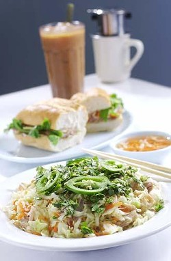 (From front) Vietnamese chicken salad - shredded chicken tossed with light seasoned vegetables and marinated shredded cabbage; banh mi thit (French sandwich) - three kinds of Vietnamese ham, sauce, and vegetables on French bread; Vietnamese iced coffee.