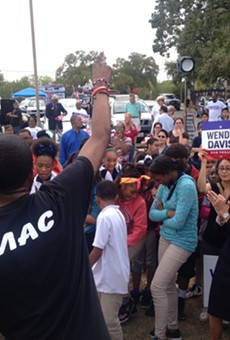 Wendy Davis dances to Real Musiq's performance at the Claude Black Center in east San Antonio