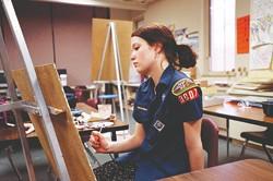 Hannah Bailey is an aspiring artist in a boring midwestern town in American Teen.