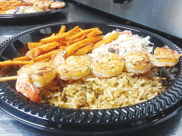 Heartwarming dirty rice and grilled shrimp - COURTESY PHOTO