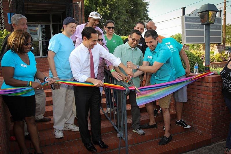 Former Mayor Julián Castro, Councilman Diego Bernal and Pride Center board chair Richard Farias joined Equality Texas field organizer Robert Salcido and others to cut the ribbon at the New PRIDE Center office in June. - FILE PHOTO