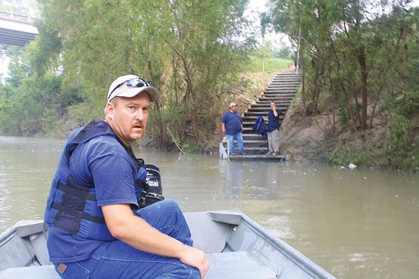 Into the wild: SARA employee Chris Svoboda hits the San Antonio River. - GREG HARMAN
