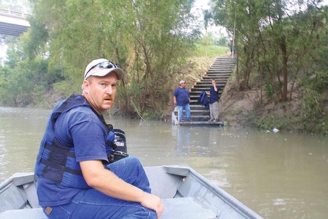 Into the wild: SARA employee Chris Svoboda hits the San Antonio River. - GREG HARMAN