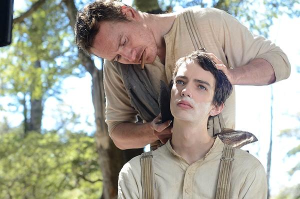 Irish bounty hunter Silas (Michael Fassbender) teaches starry-eyed teen Jay (Kodi Smit-McPhee) the ways of the trail in Slow West.