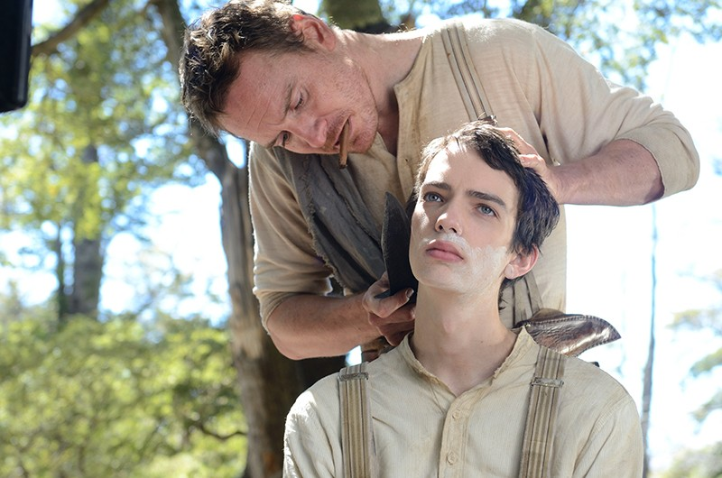 Irish bounty hunter Silas (Michael Fassbender) teaches starry-eyed teen Jay (Kodi Smit-McPhee) the ways of the trail in Slow West.