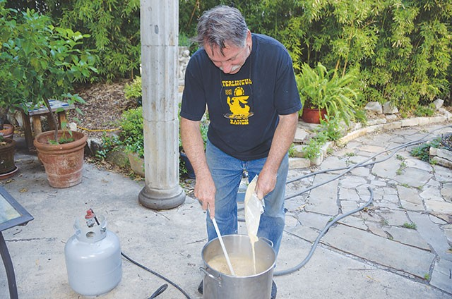 Jerry Lockey cooking a batch of beer - SCOTT ANDREWS