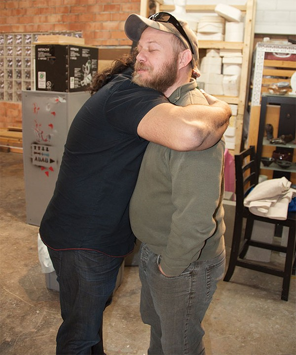 Joe Harjo and Chris Sauter hug it out - COURTESY PHOTO