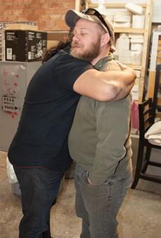 Joe Harjo and Chris Sauter hug it out