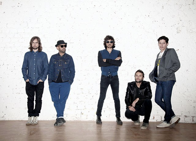 León Larregui (center) and his bandmates of two-time Latin Grammy winners Zoé - COURTESY PHOTO