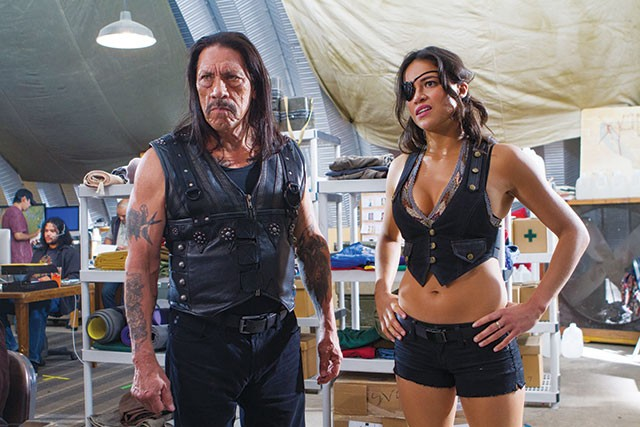 Machete (Danny Trejo) and Shé (Michele Rodríguez, who deserves her own movie) in Machete Kills - COURTESY PHOTO