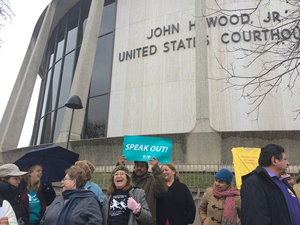 Members of the the Texas Organizing Project, Service Employees International Union of Texas, and Domesticas Unidas gathered at the John H. Wood Federal Courthouse Building on January 14, 2015, to oppose Governor-elect Greg Abbott lawsuit against President Barack Obama's executive action on immigration. - ALEXA GARCIA-DITTA