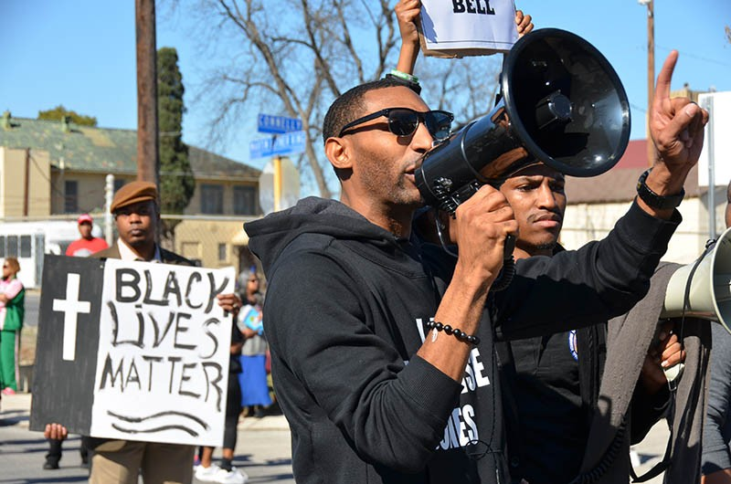 Mike Lowe of SATX4 leads some marchers in chants during Monday's MLK march. - ALBERT SALAZAR