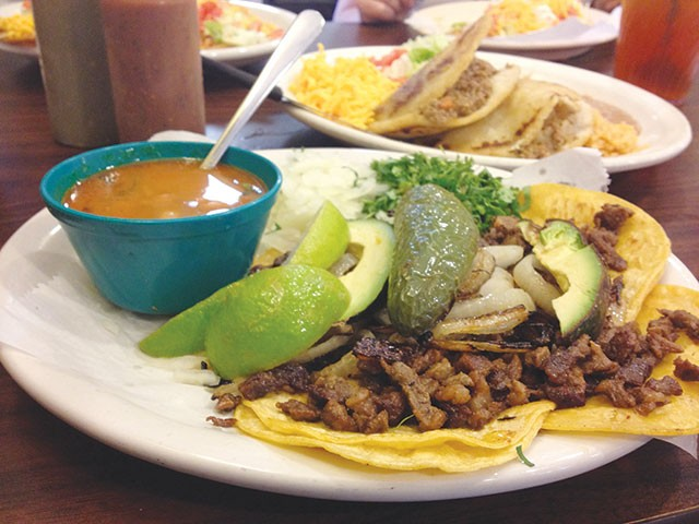 Mini tacos with pastor meat, avocados, jalapeno, lime, onions and cilantro for $6.25 - JESSICA ELIZARRARAS