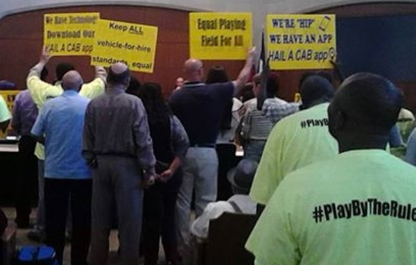Opponents of the ride-sharing companies Uber and Lyft protested in City Council chambers earlier this year, prompting Public Safety Committee members to postpone moving rules that would allow the companies to operate in San Antonio to the full City Council while another task force studies proposed rules. - MARK REAGAN