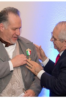 Joe Arciniega receives a medal from the Son's of the Republic of Texas after he gave a historical dramatization of his great-great-great-great grandfather Jose Miguel de Arciniega, who was twice mayor of San Antonio and helped found Bastrop.