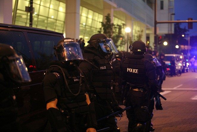 Police equipped in riot gear. - VIA FLICKR USER ALISON KLEIN, WEBN NEWS