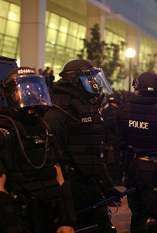 Police equipped in riot gear.