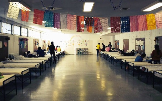 A barracks at Joint Base San Antonio—Lackland was  converted last year into a temporary shelter to house up to 1,200 children. - DEPARTMENT OF HEALTH AND HUMAN SERVICES