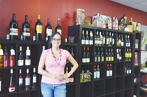 No wonder Barretto's smiling, not a bottle over $30 in her entire store - JESSICA ELIZARRARAS