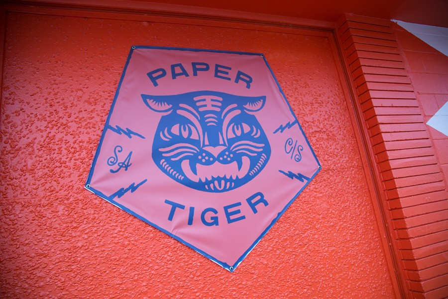 Paper Tiger's new digs feature a papel picado banner. - LINDA ROMERO