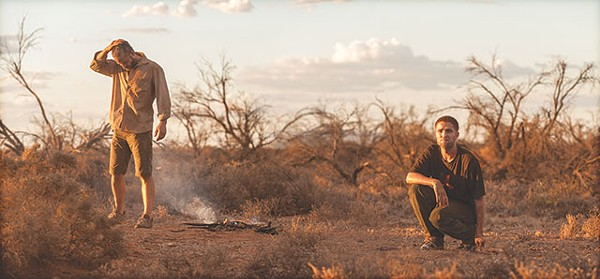 Pearce and Pattinson contemplate the best way to kill some guys, and also the best way to extinguish a campfire in the desert - COURTESY A24