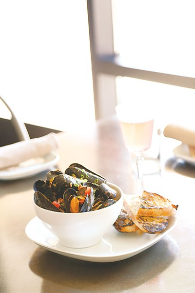P.E.I. mussels and chorizo, with orange-habanero broth - ANA AGUIRRE