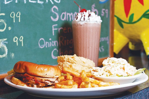Pig sandwich, fries, onion rings, cole slaw and a chocolate shake from the Pig Stand. - STEVEN GILMORE