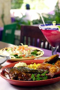 Rita's Presidio Platter - half-rack of ribs and half-chicken served with garlic mashed potatoes and fiesta corn; Rita's house salad - jicama, cucumbers, tomatoes, bacon, cheese, and tortilla strips on a bed of mixed greens with mango habanero dressing; a double prickly pear margarita.