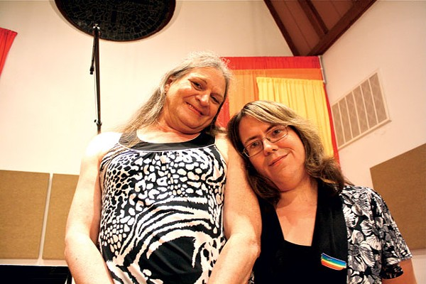 Ruby Krebs of the San Antonio Gender Association (left) shares a moment with Erin Susan Jennings, the keynote speaker at last week's Transgender Day of Remembrance. In her speech, Jennings reminded those gathered inside Metropolitan Community Church that 57 percent of transgender individuals are rejected by their families, half attempt suicide, and one out of every 12 die as murder victims, a rate that is 1,500 times higher than the general population. For more information about SAGA, visit sagender.org. - GREG HARMAN