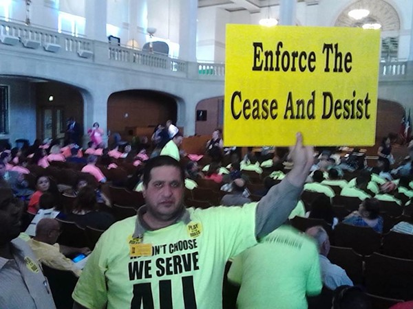 A Yellow Cab driver protests ride-share companies Uber and Lyft during a 2014 summer committee meeting. - MARK REAGAN