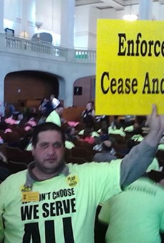 A Yellow Cab driver protests ride-share companies Uber and Lyft during a 2014 summer committee meeting.