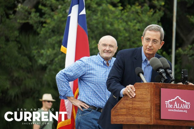 Phil Collins is joined onstage by Texas Land Commissioner Jerry Patterson in front of the Alamo on June 26, 2014. - ALBERT SALAZAR