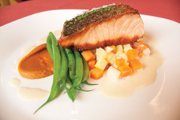 Scottish salmon and root vegetable brunoise, with Haricots verts finished in fines herbes from McCullough Avenue Grill. - VERONICA LUNA
