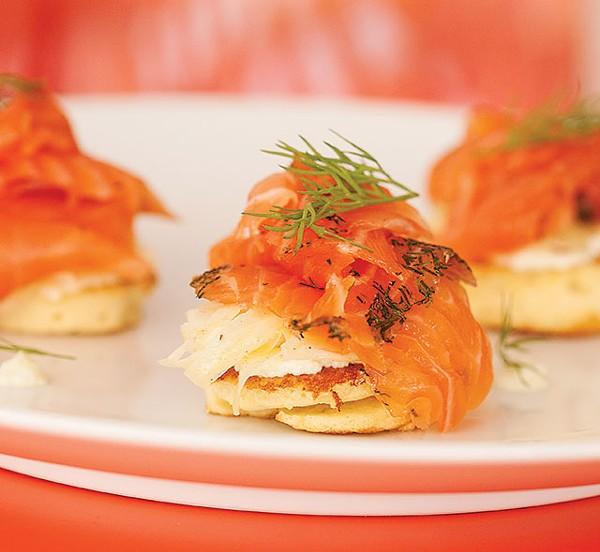 Smoked salmon atop mini pancakes - ANA AGUIRRE