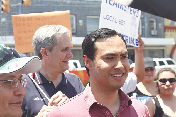 State Rep. Joaquin Castro and Austin-based Congressman Lloyd Doggett, both of whom have announced they're running for a newly formed congressional stretching through San Antonio, march at a July Fourth immigrant rights rally on the city's Westside. - MICHAEL BARAJAS