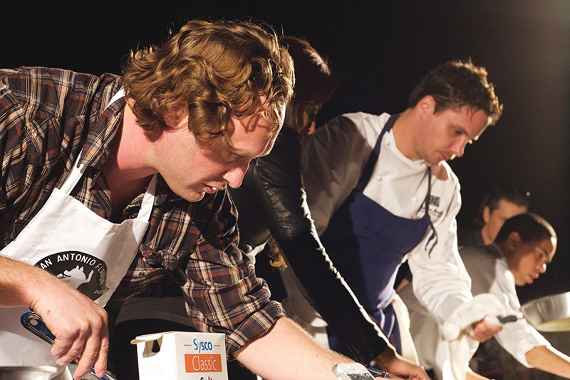 Stefan Bowers (left) and Robbie Nowlin (purple apron), pals and competitors during San Antonio Flavor culinary throwdown in March. - FILE PHOTO
