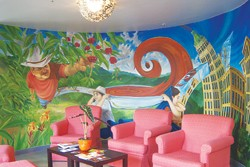 Step down into the artsy, Fair Trade vibe at Blue Star's Lazarus Coffee House.