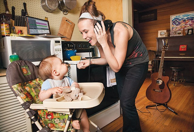 Supermom—Bekah Kelso singing to son Kaius while cooking and recording - DANIELA RIOJAS