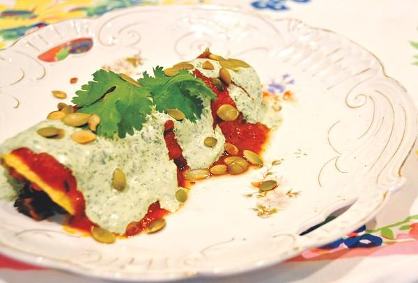Sweet potato, black bean, and swiss chard enchiladas con cilantro crema - PHOTO BY XELINA FLORES