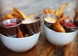 French fries with ketchup and Monty Sauce at The Monterey. - ALBERT SALAZAR