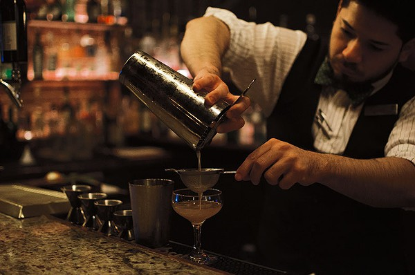 Take in great blues folklore and great booze at Bar 414. - JAIME MONZON