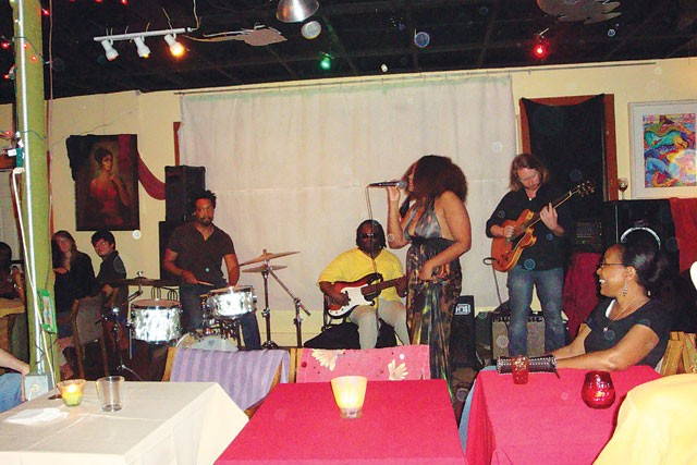 Tameca Jones leads her band through a soulful set at Carmens de la Calle Café. - ASHLEY FEINBERG