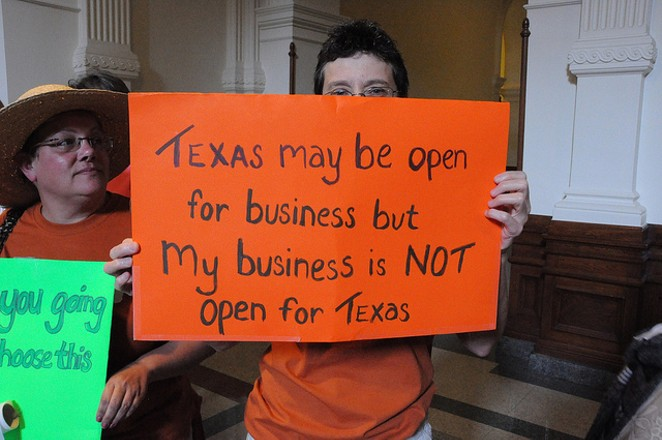 A protestor rallies against abortion restrictions during the previous Legislative session. - VIA FLICKR USER ANN HARKNESS