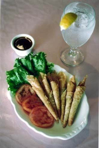 Thai Dee's delicate shrimp rolls - fried spring roll sheets housing chopped shrimp and celery - served with honey drenched sweet and sour sauce.