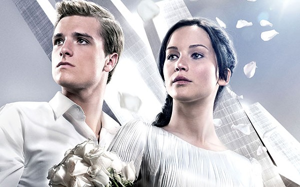 The Dating Games: Katniss (Jennifer Lawrence) and Peeta (Josh Hutcherson) try to keep up appearances - COURTESY PHOTO