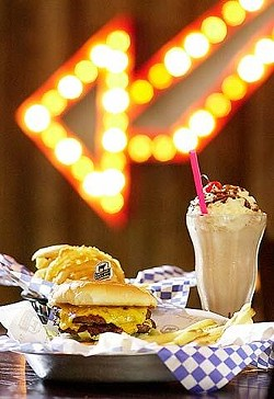 The double Lucky with cheese served with fresh-cut fries, an order of homemade onion rings, and a chocolate shake.