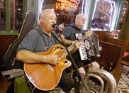 The duo of Rimmie and Bob play German-style music on a recent weekend night at Schilo's Delicatessen. The deli provides live music on Friday and Saturday nights.