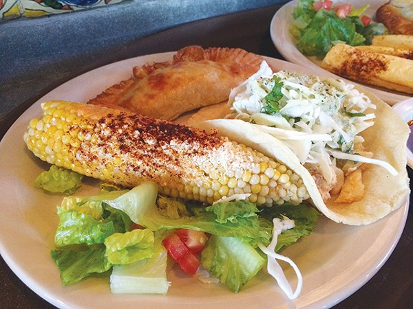 The spicy roasted corn will get all over your face—in a good way - COURTESY PHOTO